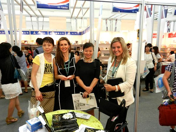 Linda (right) with an Author-in-Booth and Chinese Publishers at Beijing